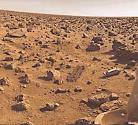 The surface of Mars was sampled for signs of life by the Viking 2  lander in 1976. A mechanical sampling arm dug the grooves near the round  rock at the lower left. The cylinder at the right covered the sampling  device and was ejected after landing.