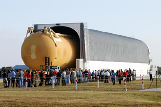 The External Tank is rolled out of the barge