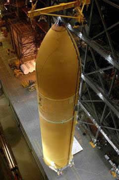 The External Tank is lifted to the verticle position inside the Vehicle Assembly Building.