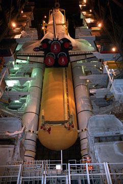The orbiter is lifted before being mated to the External Tank and twin Solid Rocket Boosters in the Vehicle Assembly Building.
