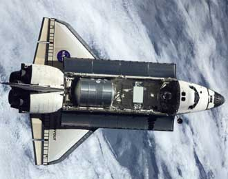 Space Shuttle Endeavour carries the Raffaello logistics module to the Space Station during STS-108.