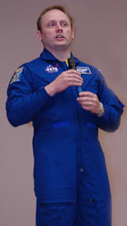 Astronaut Mike Fincke talks to workers at NASA's Kennedy Space Center.