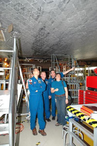 STS-114 crewmembers inspect Discovery