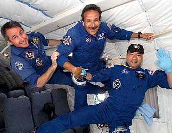 STS-114 Mission Specialists, from left, Steve Robinson, Charlie Camarda and Soichi Noguchi