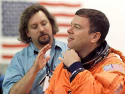 STS-114 Pilot James Kelly, right, with suit technician Len Groce