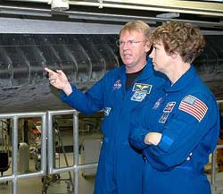 STS-114 Mission Specialist Andy Thomas, left, and Commander Eileen Collins