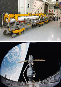 The orbiter's Canadarm is outfitted with a new sensor boom.