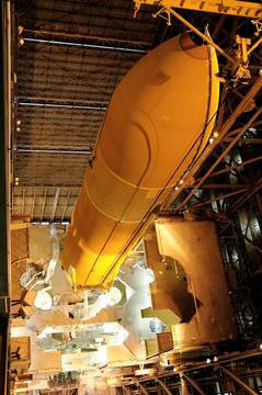 The External Tank is shown as it is lifted inside the Vehicle Assembly Building.