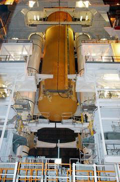 The External Tank is lowered for mating with the twin Solid Rocket Boosters.
