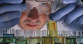 Researcher works on NanoCeram (R) syringe filters in laboratory.