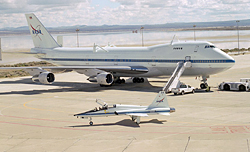 T-38 taxis past a 747 Shuttle Carrier aircraft.