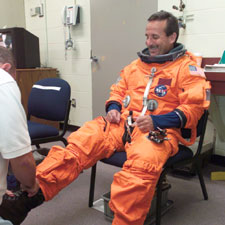 Astronaut Charles Camarda dons a training suit.