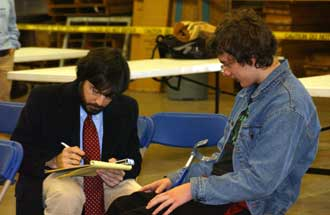 Jordan Greene, right, a ninth-grader at New Century Technology High School in Huntsville, Ala., and member of the school's FIRST Robotics Team, is interviewed by writer Grant Thompson.