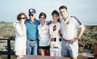 Former astronaut Mike Mullane poses with his wife and family during a pre-launch barbeque at the beach house.
