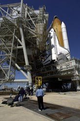 Photographers capture the rollback of the Rotating Service Structure from around Space Shuttle Discovery on Launch Pad 39B.