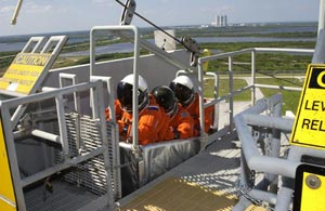 The Expedition 6 crew practice emergency egress from the 195-foot level of the Fixed Service Structure on Launch Pad 39A.