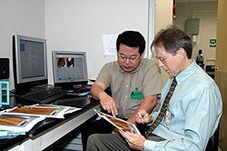 Drs. Xu and Durrance look at images from the atomic force microscope.