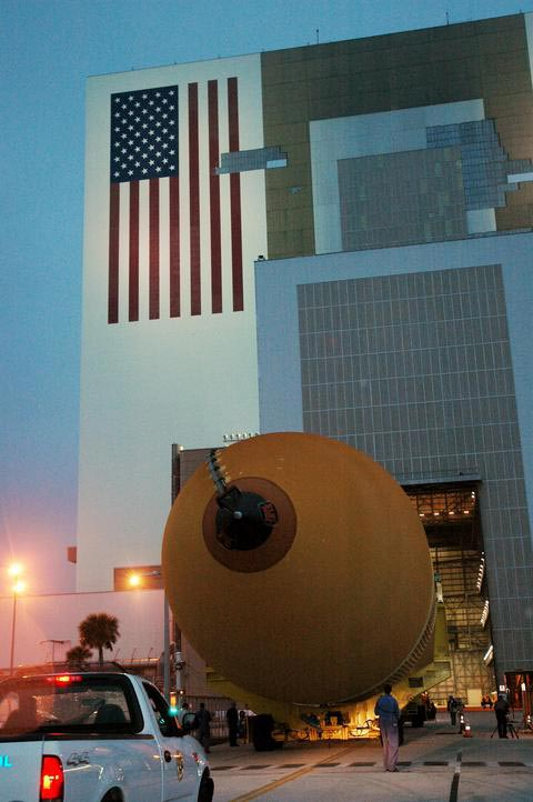 The second redesigned External Tank is shown as it moves toward the open doors in the Vehicle Assembly Building at NASA's Kennedy Space Center.