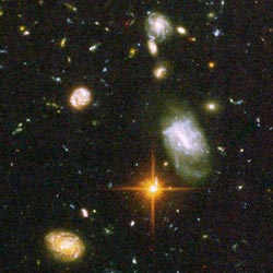 "The image ""http://www.nasa.gov/images/content/110948main_galaxy_distant.jpg"""