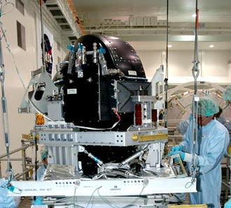 A technician in the Space Station Processing Facility prepares the Control Moment Gyroscope for flight.