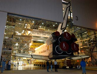 The Space Shuttle Discovery rolls into the Vehicle Assembly Building at NASA's Kennedy Space Center.