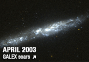 Photo of spiral galaxy NGC 55 taken by the Galaxy Evolution Explorer orbiting space telescope.