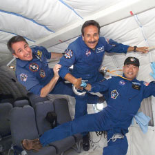 STS-114 Mission Specialist Steve Robinson and two crewmates