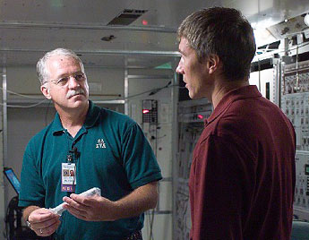 Expedition 11 NASA ISS Science Officer John Phillips, left, talks with Commander Sergei Krikalev