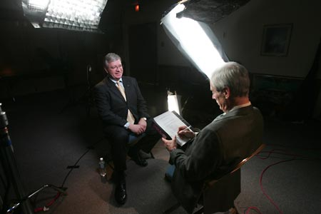 Reporter Bob Simon (right) interviews NASA's Bruce Holmes