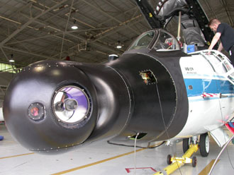 Ascent Video Experiment equipment is mounted on the nosecone of a NASA WB-57 jet.