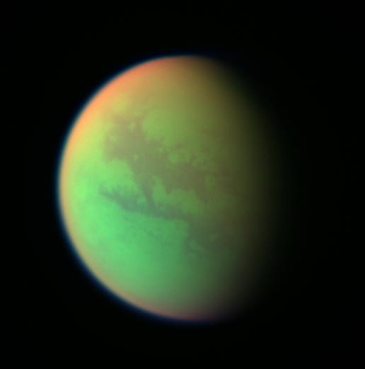 false-color view of Titan, showing soft greens, reds and blues