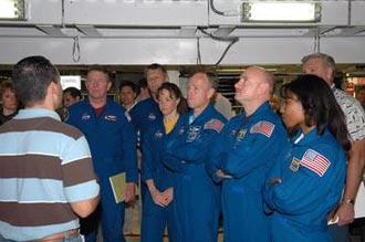 The astronauts of the second Return to Flight mission, STS-121, are shown at NASA's Kennedy Space Center's Orbiter Processing Facility.