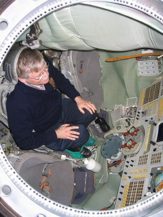 NASA Chief Historian Steven J. Dick in a Soyuz simulator