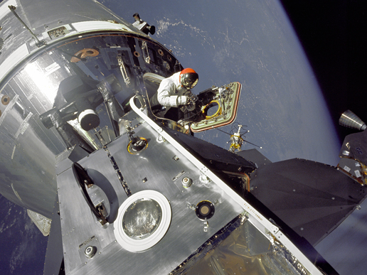 Astronaut Dave Scott stands in the hatch of the module