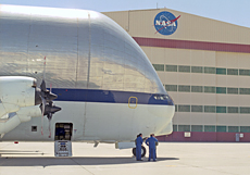 NASA's Super Guppy dwarfs its flight crew.