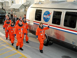 The STS-114 crew departs for Launch Pad 39B