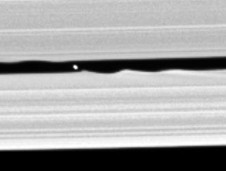 a newly-discovered small moon seen within the Keeler gap in Saturn's rings