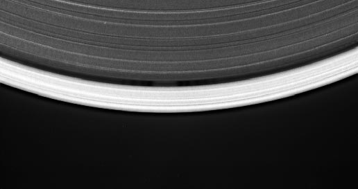 small moon orbiting within the narrow Keeler gap of Saturn's rings