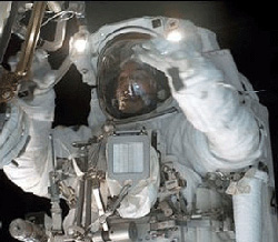 An astronaut on EVA using headlamps