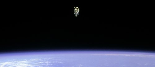Astronaut in a jet pack in earth orbit.