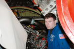 Pilot James Kelly looks at an engine