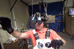 Mission Specialist Stephen Robinson using virtual reality equipment