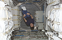 Astronaut Daniel W. Bursch, Expedition Four flight engineer, floats in the Leonardo Multi-Purpose Logistics Module (MPLM)