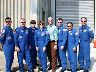 NASA engineer Bill McQuade is pictured with the STS-114 astronauts in January at NASA's Kennedy Space Center in Florida.