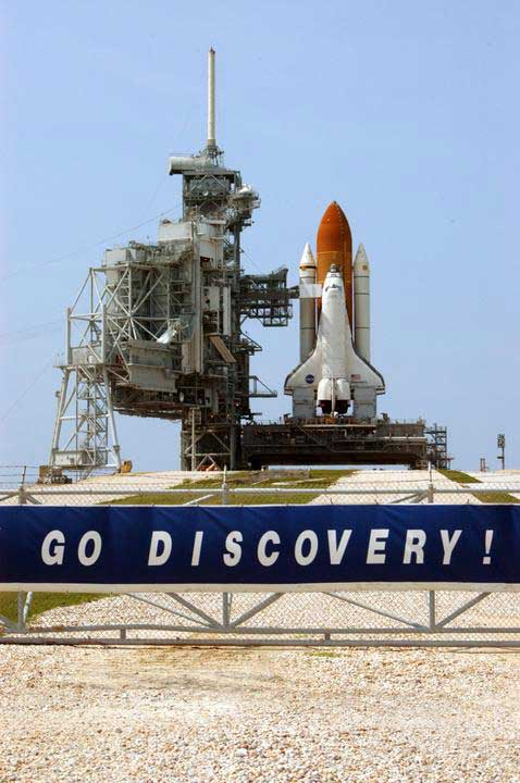 Space Shuttle Discovery is revealed after rollback of the Rotating Service Structure.