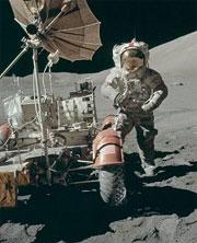An Apollo astronaut on the moon with a lunar rover