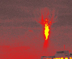 Photo shows what appears to be a burning tree but is actually a red sprite in Tainan City Taiwan.