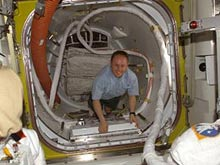 Expedition 9 NASA ISS Science Officer Mike Fincke inside Quest Airlock