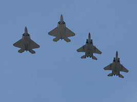 F-22s and F-15s fly over the historical marker unveiling ceremony