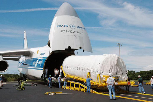 A second stage Centaur engine is delivered from the mouth of a Russian cargo plane on June 6, 2005 at Kennedy Space Center.